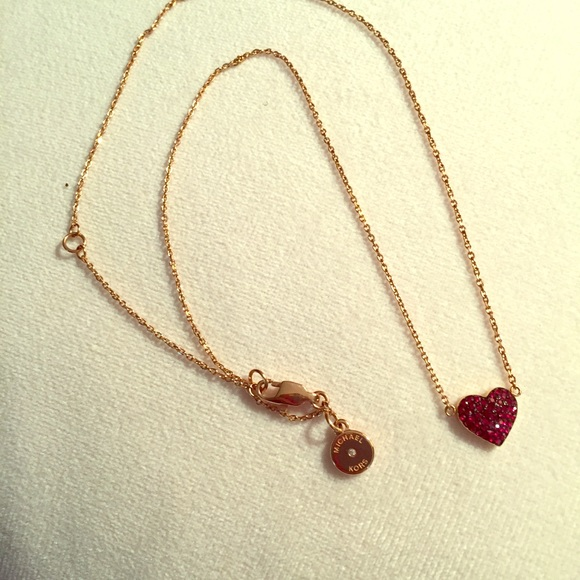 ef1a40ab8b1bc Michael Kors rose gold red pave heart necklace. M 5c327a962beb79e2f21de570